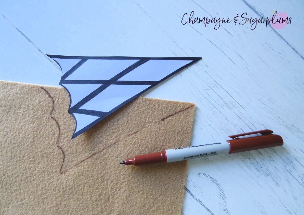 Tracing cone template onto tan felt by Champagne and Sugarplums