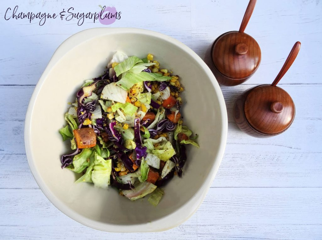 Quinoa Salad with red cabbage and sweet potatoes in a white bowl by Champagne and Sugarplums