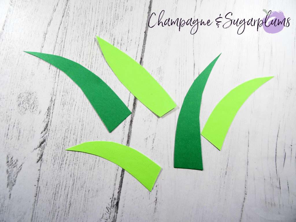 Cutting pineapple fronds from green paper by Champagne and Sugarplums