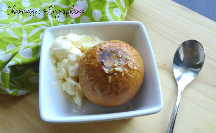 Baked Apples with ice cream in a white dish by Champagne and Sugarplums
