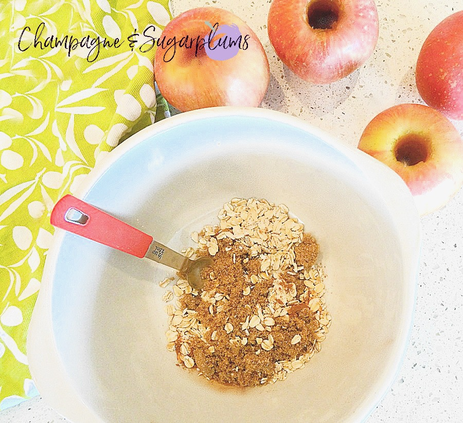 Oats, brown sugar and cinnamon in a mixing bowl by Champagne and Sugarplums