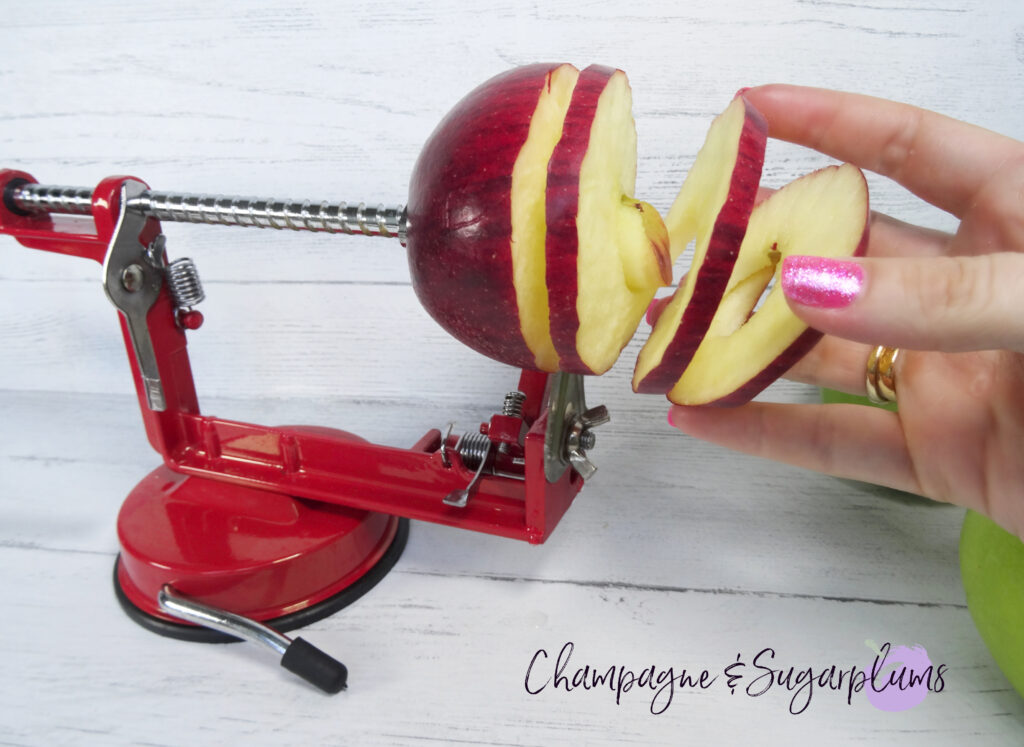 Using an apple corer to make apple rings by Champagne and Sugarplums