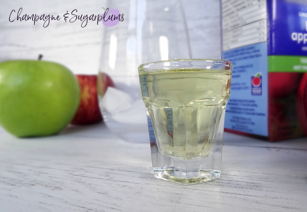 Apple juice in a shot glass by Champagne and Sugarplums