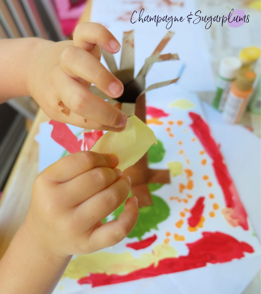 Adding the leaves! Paper Bag Tree Kids Craft for Thanksgiving