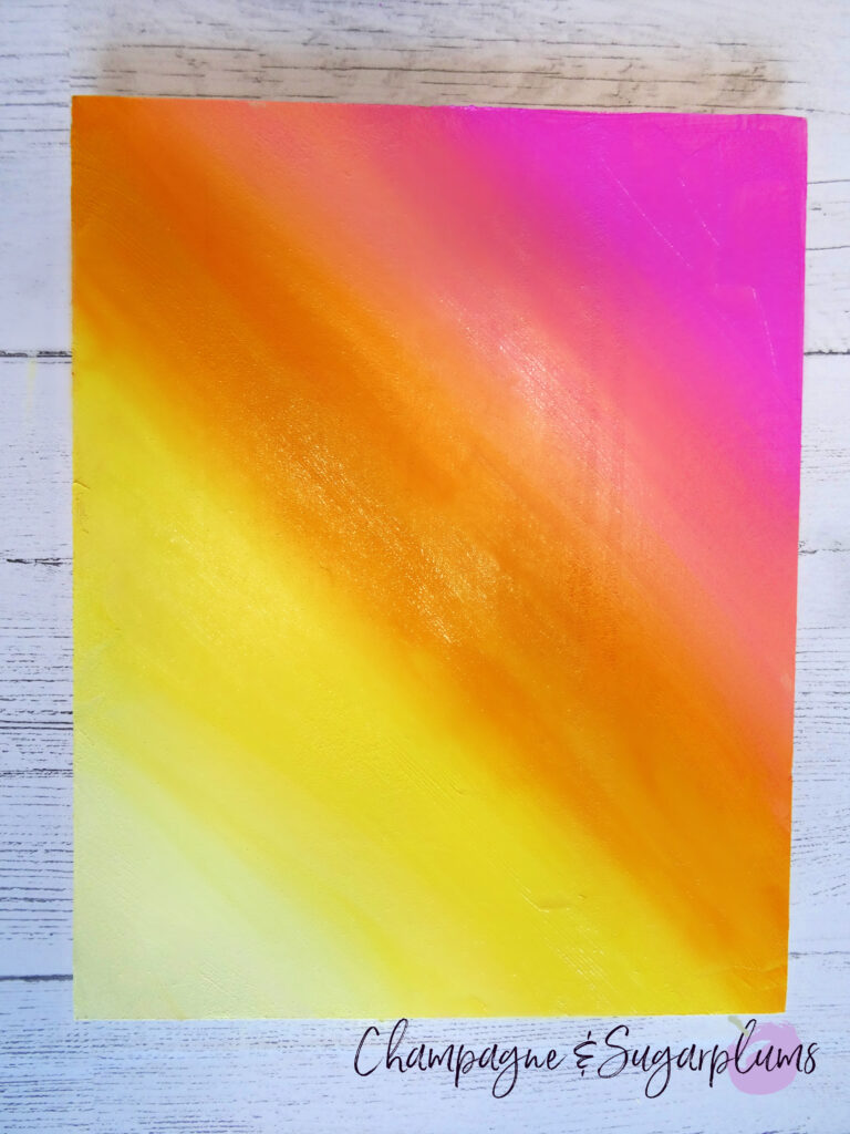 Brightly painted wood board in pinks, oranges and yellows by Champagne and Sugarplums