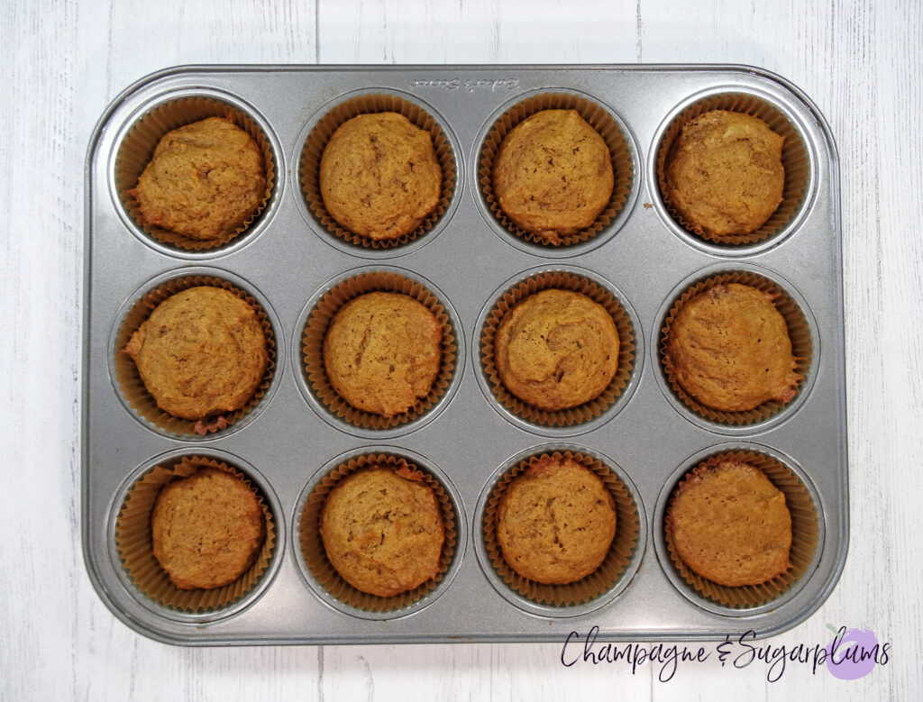 Cupcakes in a muffin tin on a white background by Champagne and Sugarplums