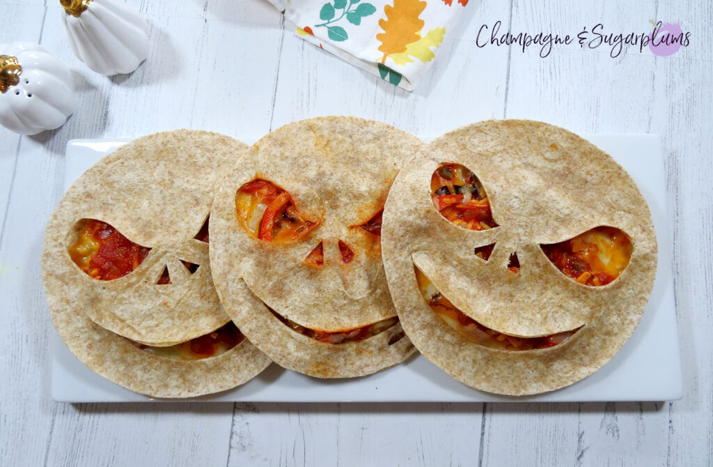 Three Creepy Quesadillas on a white plate by Champagne and Sugarplums