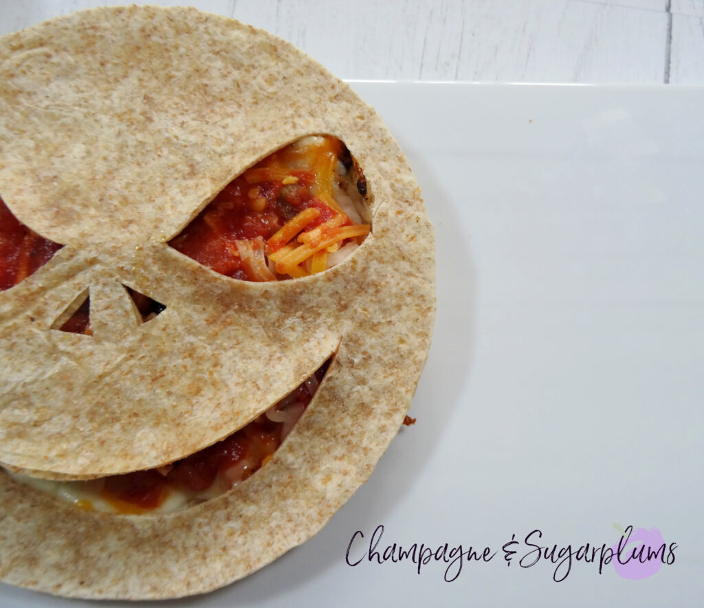 Creepy Quesadilla on a white plate by Champagne and Sugarplums