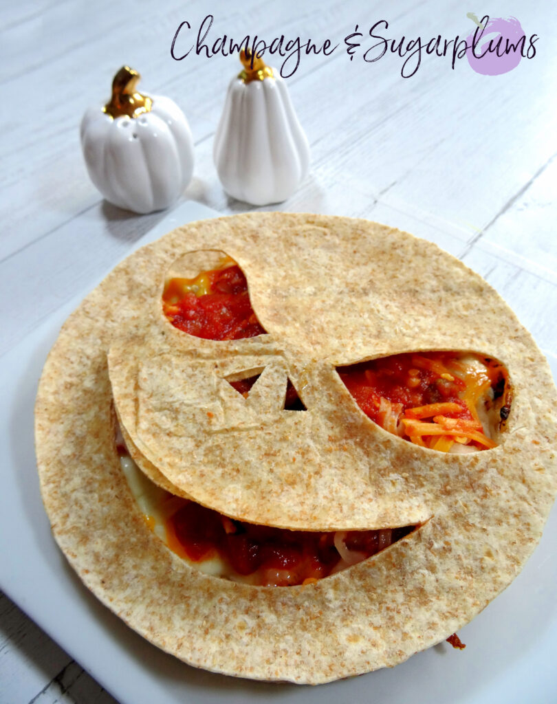 Creepy Quesadillas on a white plate by Champagne and Sugarplums