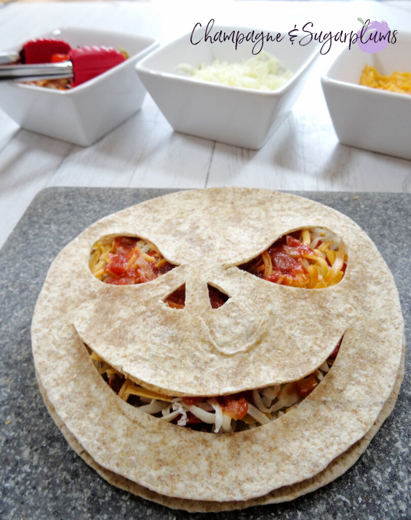 Creepy Quesadillas on a gray cutting board by Champagne and Sugarplums