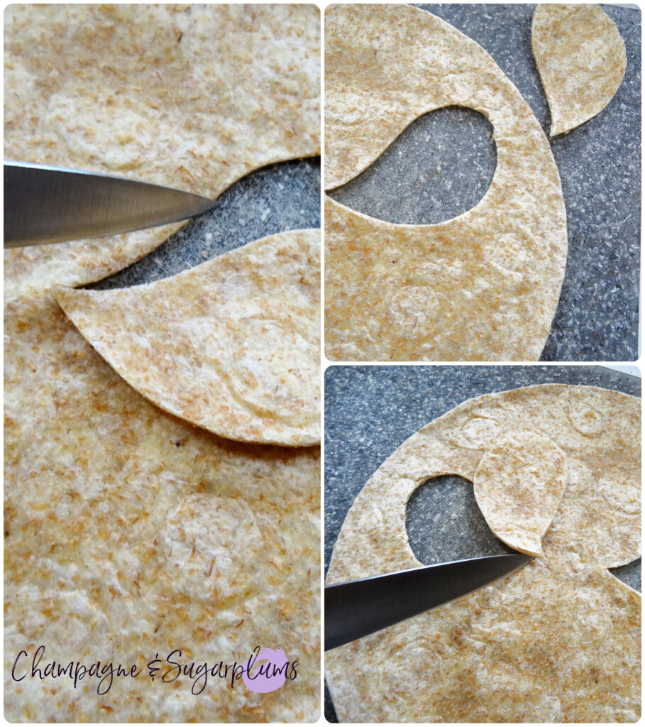 Cutting scary eyes into a tortilla on a grey cutting board by Champagne and Sugarplums