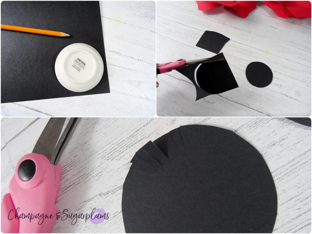Cutting a black paper circle from paper and fringing the edges by Champagne and Sugarplums