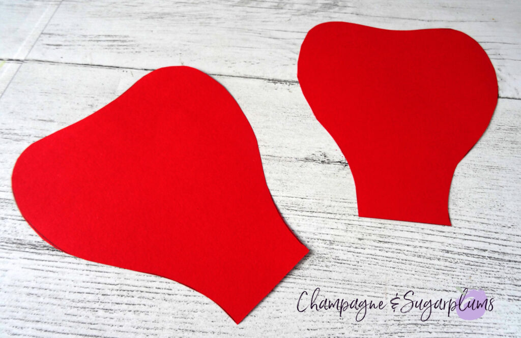 Flower petals cut from red paper by Champagne and Sugarplums