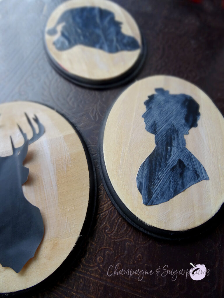 Gluing Santa, Mrs. Claus and Rudolph silhouettes to wood boards by Champagne and Sugarplums