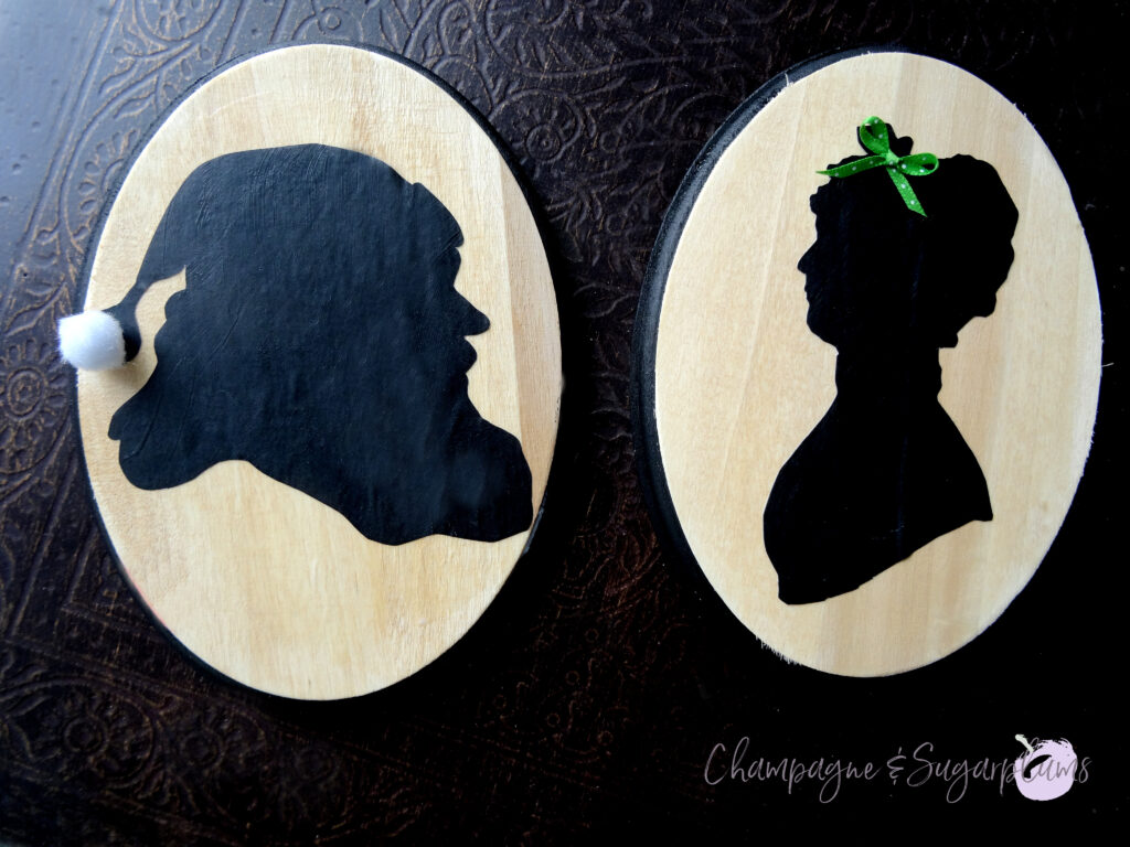 Santa and Mrs. Claus silhouettes on a dark background by Champagne and Sugarplums