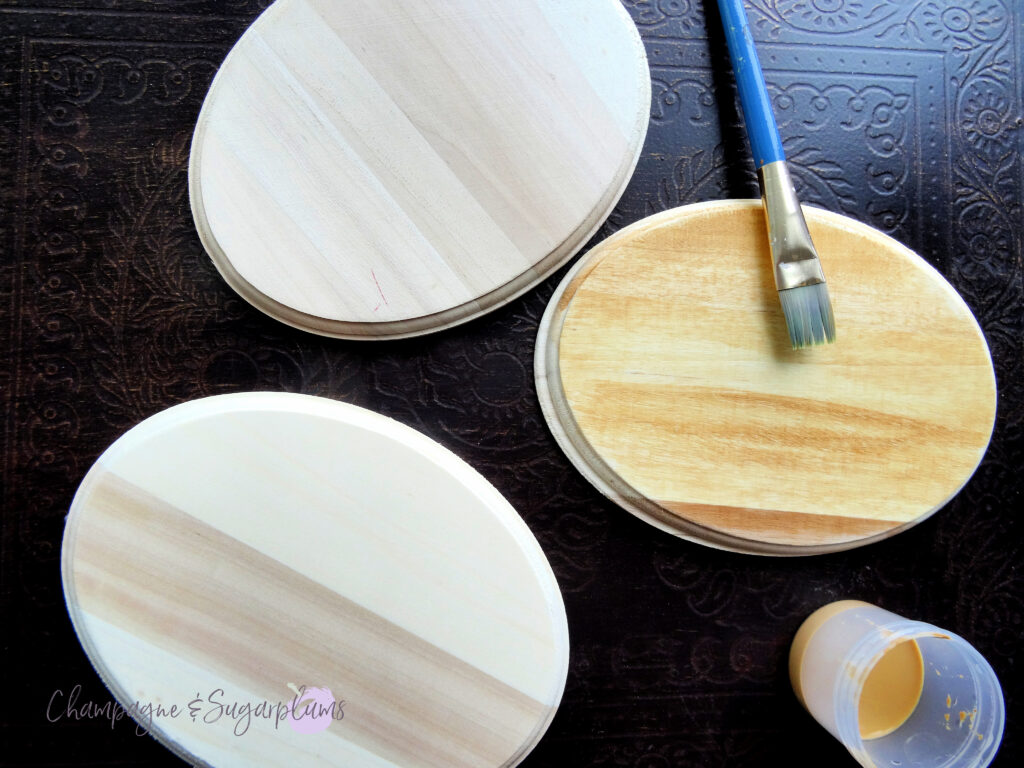 Painting the faces of three oval wood boards with a brown wash by Champagne and Sugarplums