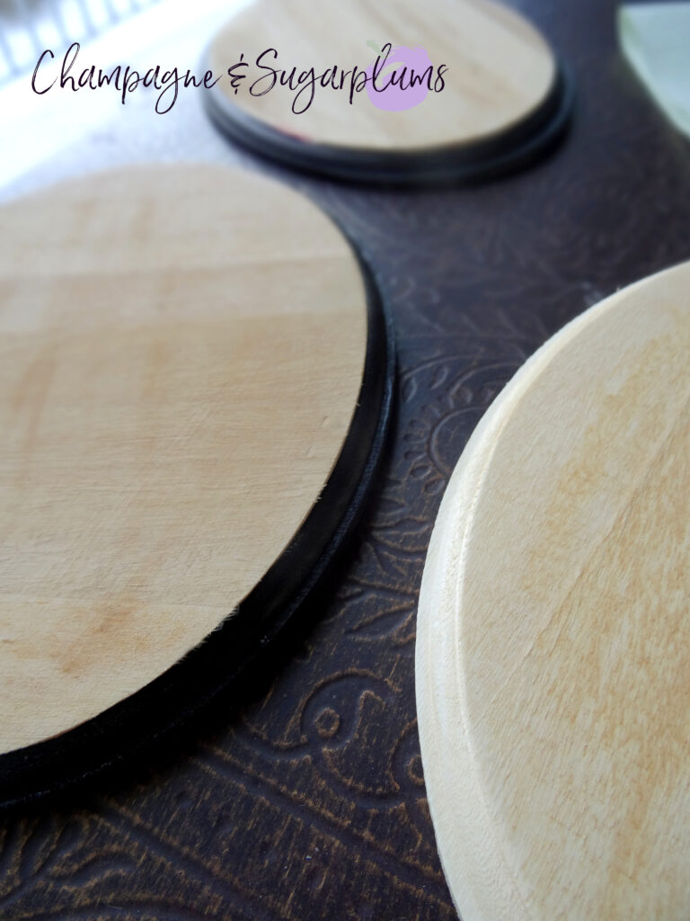 Painting the edges of three oval wood boards black by Champagne and Sugarplums