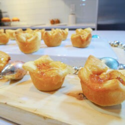 Brie mango bites on a wood tray by Champagne and Sugarplums
