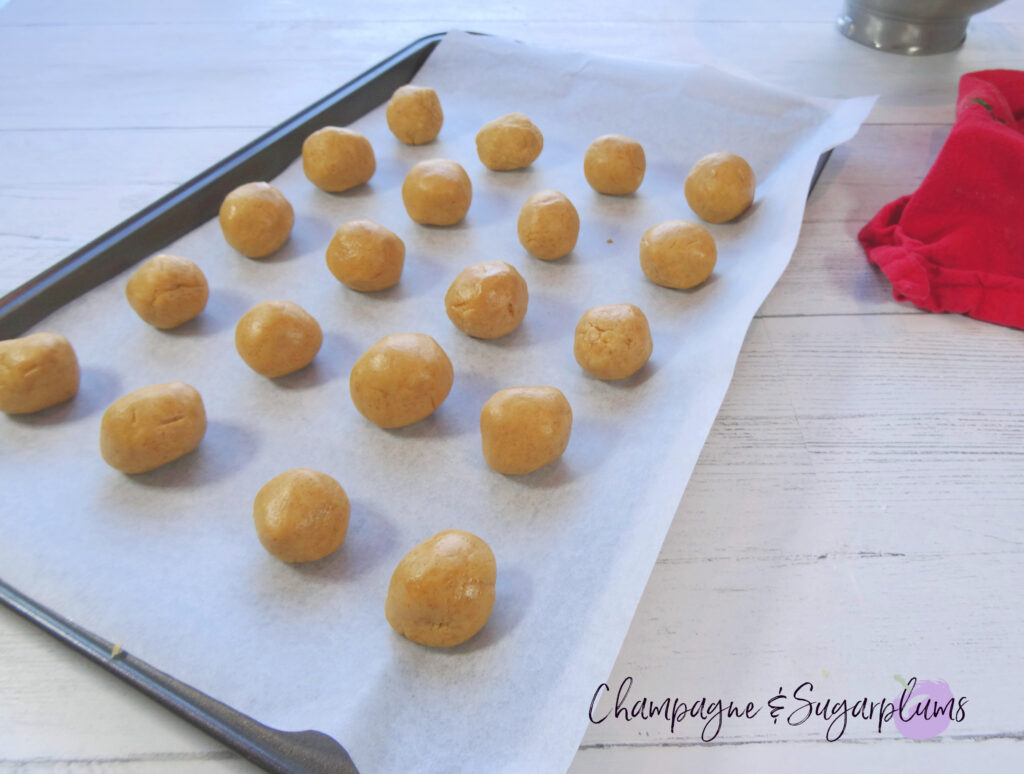 Snowball treats on a baking tray by Champagne and Sugarplums