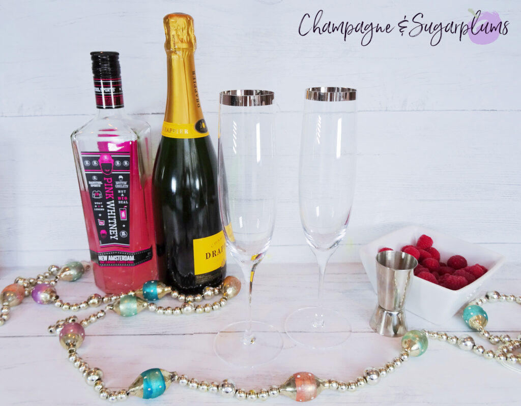 Ingredients to make a cocktail on a white background by Champagne and Sugarplums