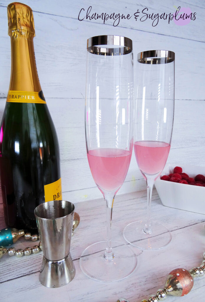 Adding Pink Whitney Vodka to champagne flutes by Champagne and Sugarplums