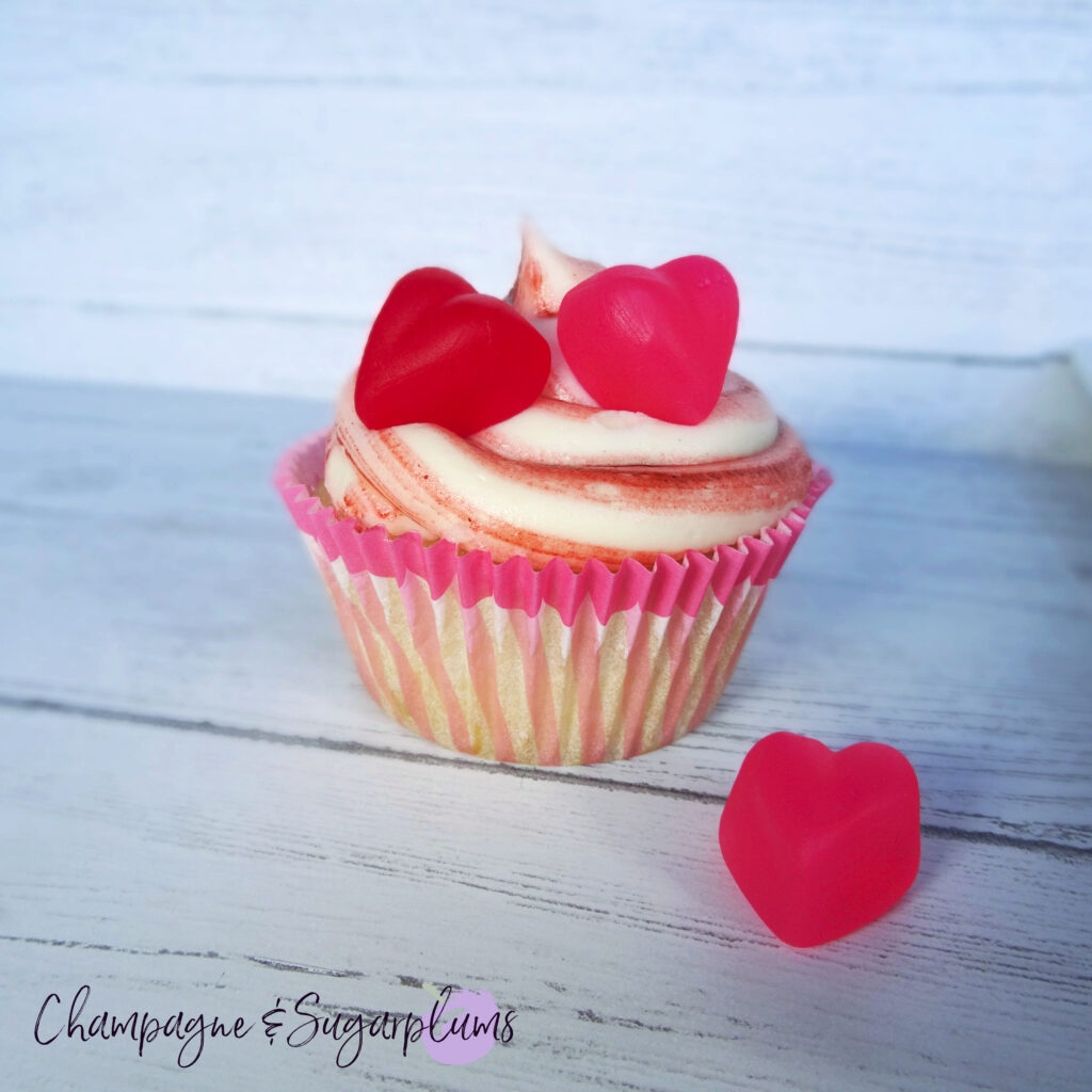 A Cherry Cupcake on a white background with a pink candy heart by Champagne and Sugarplums