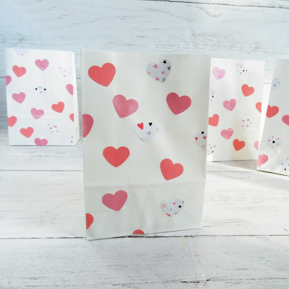 Valentine goodie bag with pink hearts on a white background by Champagne and Sugarplums
