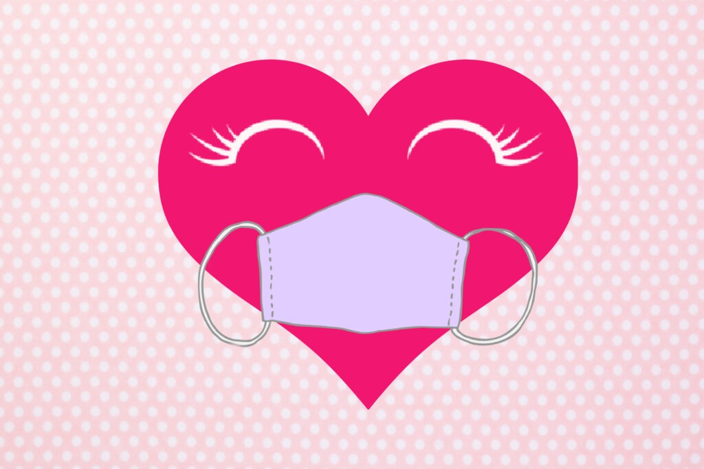 Free printable COVID themed pink dotted Valentine card with a heart wearing a mask on it by Champagne and Sugarplums