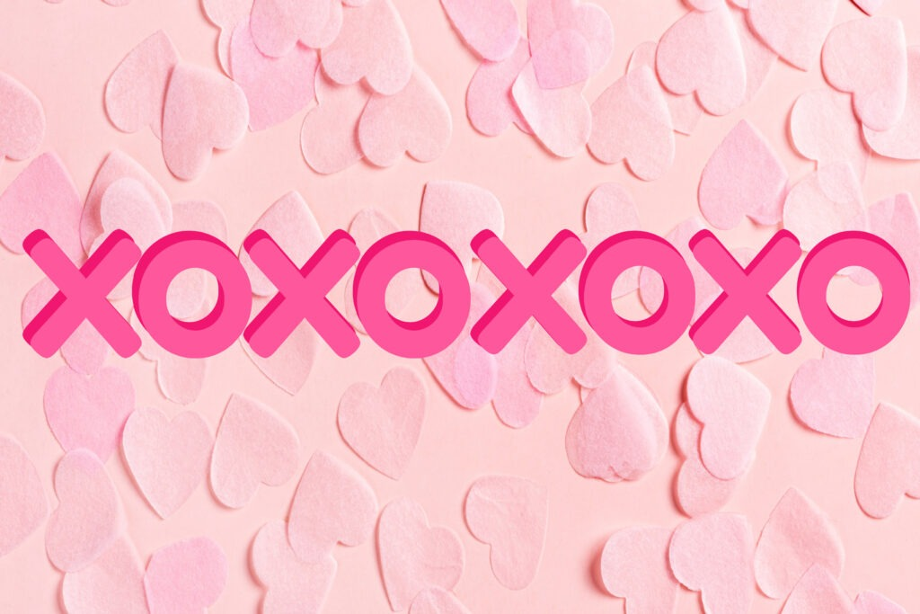 Pink heart background Valentine card with xoxoxoxo on it by Champagne and Sugarplums